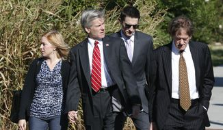 Former Virginia Gov. Bob McDonnell, second left, and his daughter Cailin, left, arrive at Federal Court with attorney Henry Asbill, right, in Richmond, Va., Tuesday, Aug. 26, 2014.  McDonnell is in his fifth day of testimony in his corruption trial. He and his wife, Maureen, are charged with accepting more than $165,000 in gifts and loans from former Star Scientific Inc. CEO Jonnie Williams in exchange for promoting his company's dietary supplements.  (AP Photo/Steve Helber)