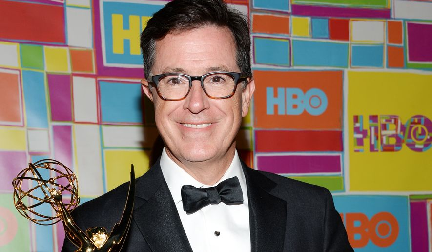 Stephen Colbert arrives at HBO's Post Emmy Awards reception on Monday, Aug. 25, 2014 in West Hollywood, Calif. (Photo by Evan Agostini/Invision/AP)