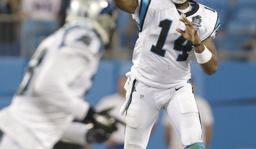 FILE - In this Aug. 8, 2014, file photo, Carolina Panthers' Joe Webb (14) throws a pass against the Buffalo Bills during the second half of a preseason NFL football game in Charlotte, N.C. Panthers third-string quarterback Joe Webb could be the beneficiary of a rib injury to Cam Newton. The Panthers only kept two QBs last season, but with Newton hurting coach Ron Rivera is strongly considering keeping three QBs. (AP Photo/Bob Leverone, File)