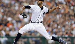 Detroit Tigers pitcher David Price throws against the New York Yankees in the first inning of a baseball game in Detroit, Wednesday, Aug. 27, 2014. (AP Photo/Paul Sancya)