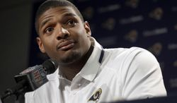 FILE - In this May 13, 2014, file photo, St. Louis Rams seventh-round draft pick Michael Sam listens to a question during a news conference at the NFL football team's practice facility in St. Louis. Sam and the Rams visit the Miami Dolphins on Thursday night,  Aug. 28, 2014, the last exhibition for both clubs and the last opportunity for players to state their cases before teams pare down their rosters to the NFL-mandated 53 by Saturday afternoon. (AP Photo/Jeff Roberson, File)