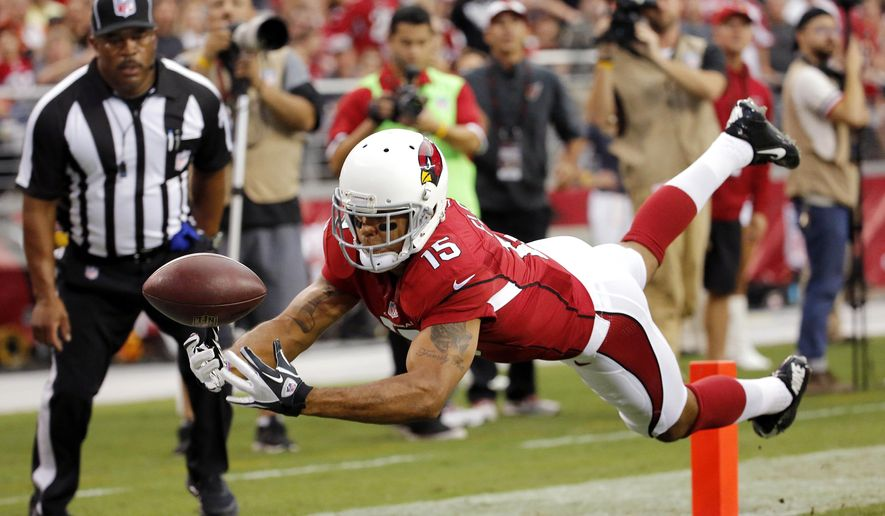 10ThingstoSeeSports - Arizona Cardinals wide receiver Michael Floyd cannot hold onto a pass against the Cincinnati Bengals during the first half of an NFL preseason football game, Sunday, Aug. 24, 2014, in Glendale, Ariz. (AP Photo/Matt York, File)
