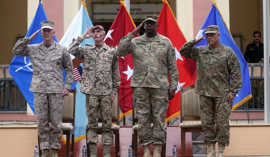 Outgoing commander of ISAF, U.S. Gen. Joseph Dunford, first left, and incoming U.S. Army Commander for International Security Assistance Forces (ISAF), Gen. John F. Campbell, first right, salute during a change of command ceremony at the ISAF Headquarters in Kabul, Afghanistan, Tuesday, Aug. 26, 2014. ISAF is a NATO-led security mission in Afghanistan that was established by the United Nations Security Council in 2001. It will end its mission at the end of 2014. (AP Photo/Massoud Hossaini)