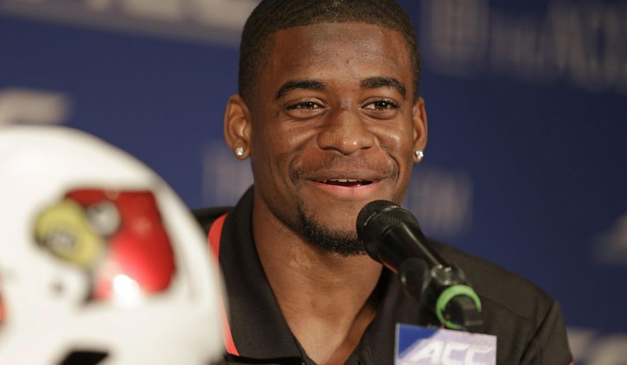 FILE - Louisville's Devante Parker answers a question during a news conference at the Atlantic Coast Conference Football kickoff in Greensboro, N.C., in this July 20, 2014 file photo.  Parker broke his foot at practice late last week and is expected to miss at least six weeks. Parker set a school record with 12 TD catches last season and has first-round draft pick talent.(AP Photo/Chuck Burton, File)