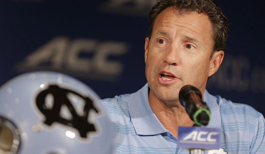 "FILE - In this July 21, 2014, file photo, North Carolina coach Larry Fedora answers a question during a news conference at the Atlantic Coast Conference football kickoff in Greensboro, N.C. Fedora says the team has suspended four players for this weekend's season opener, a day after a report of an alleged hazing altercation left a walk-on receiver with a possible concussion. Fedora said Wednesday, Aug. 27, the four players were suspended for a ""violation of team policy,"" but offered no other details about what rules were broken. (AP Photo/Chuck Burton, File)"