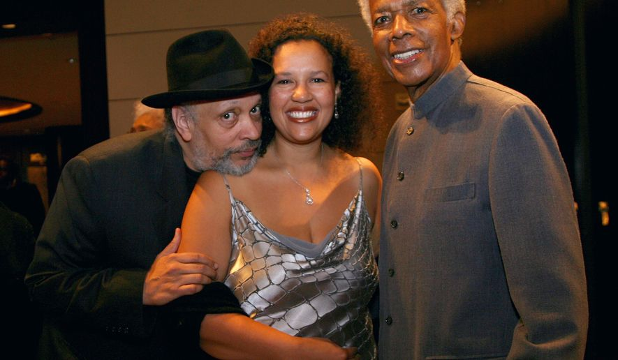 "FILE- In this Oct. 6, 2006 file photo, author Walter Mosely, left, Elinor R. Tatum, publisher and editor-in-chief of the Amsterdam News, center, and documentary filmmaker William Greaves  attend the 80th anniversary celebration of Harlem's Schomburg Center at Jazz at Lincoln Center in New York. Greaves, the Emmy-award winning producer and co-host of the groundbreaking ""Black Journal"" and a prolific and adventurous filmmaker whose subjects ranged from Muhammad Ali to the Harlem Renaissance to the black middle class, has died. He was 87. (AP Photo/Rick Maiman, file)"