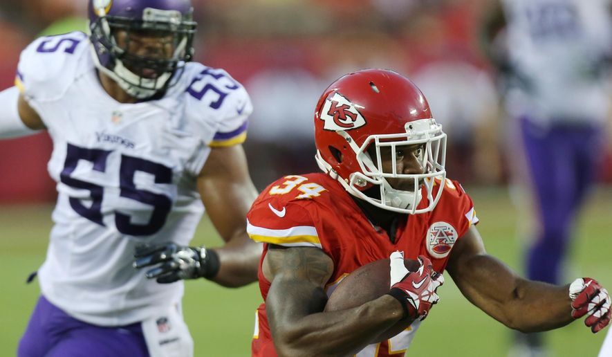 Kansas City Chiefs running back Knile Davis (34) runs from Minnesota Vikings linebacker Anthony Barr (55) during the first half of an NFL preseason football game in Kansas City, Mo., Saturday, Aug. 23, 2014. (AP Photo/Ed Zurga)