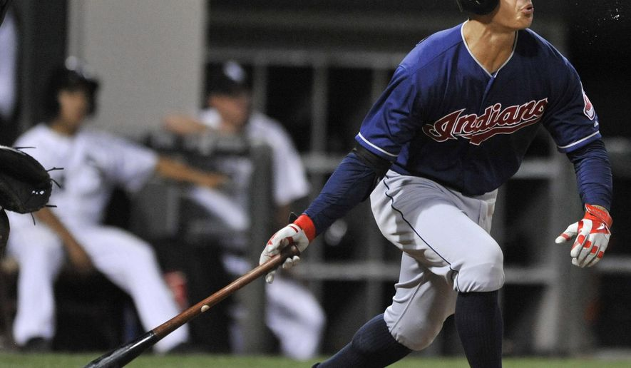 Cleveland Indians' Zach Walters watches his two-run home run during the 10th inning of a baseball game against the Chicago White Sox in Chicago, Tuesday, Aug. 26, 2014. (AP Photo/Paul Beaty)