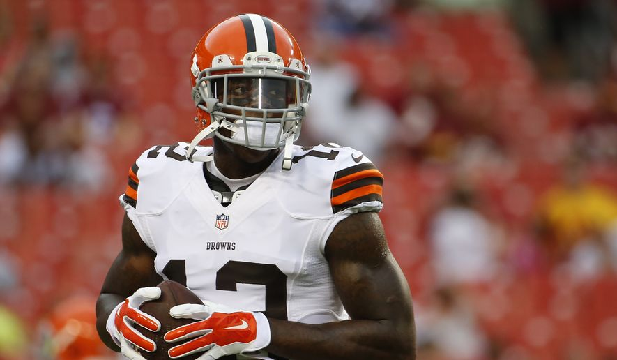 Cleveland Browns wide receiver Josh Gordon (12) warms up before an NFL preseason football game against the Washington Redskins on Monday, Aug. 18, 2014, in Landover, Md. (AP Photo/Evan Vucci)