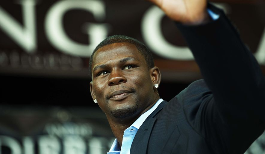 FILE - In this July 14, 2009, file photo, boxer Jermain Taylor gestures during a news conference in Copenhagen, Denmark. A judge has set bail at $25,000 for boxer Jermain Taylor after the former middleweight champion was jailed overnight in Little Rock, Ark., in connection with a shooting that wounded his cousin. Taylor appeared via video from the Pulaski County jail for an initial appearance Wednesday, Aug. 27, 2014. (AP Photo/POLFOTO, Jens Dige, File)   DENMARK OUT