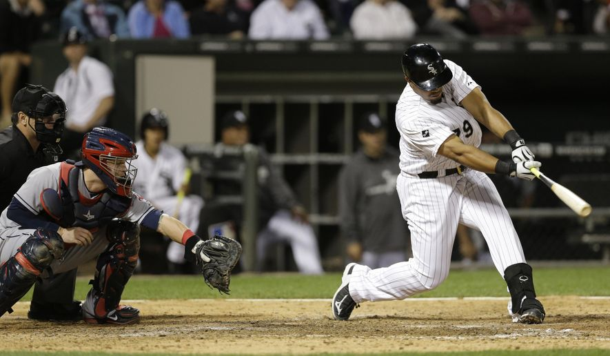 Chicago White Sox's Jose Abreu hits an one-run single against the Cleveland Indians during the seventh inning of a baseball game in Chicago, Wednesday, Aug. 27, 2014. (AP Photo/Nam Y. Huh)