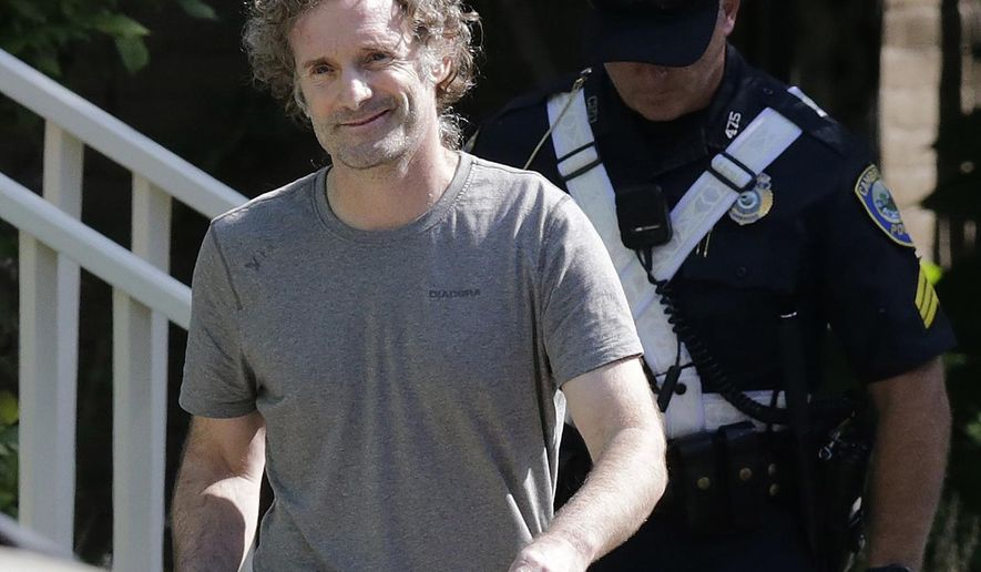 "Peter Theo Curtis smiles as he walks towards reporters to read a statement outside his mother's home in Cambridge, Mass., Wednesday, Aug. 27, 2014. The release of the U.S. journalist Curtis by Syrian captors has prompted ""60 Minutes"" to issue portions of an interview with a fellow ex-hostage that the show had edited last year to remove references to Curtis. CBS said on the web site Wednesday that the details were omitted ""in the interest of Curtis' safety."" (AP Photo/Charles Krupa, file)"