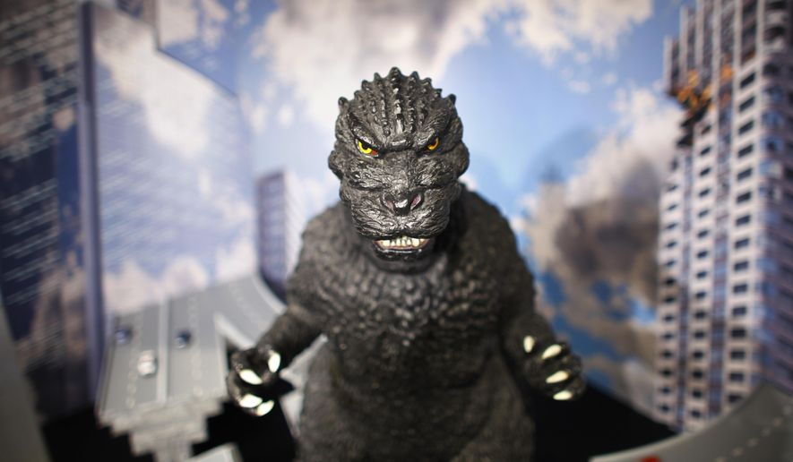 FILE - In this April 28, 2014 file photo, a large size figure of Godzilla in a diorama is on display at Cheepa's gallery in Tokyo. At a humble Tokyo laboratory, Godzilla, including the 1954 black-and-white original, is stomping back with a digital makeover that delivers four times the image quality of high definition. Experts say the chemical reactions used to make old movies stored far greater detail than was visible with the limited projection technology of the era, as well as with subsequent digital updates. (AP Photo/Junji Kurokawa, File)