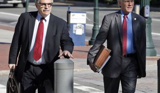 Former Virginia Gov. Bob McDonnell, right, arrives at federal court with his attorney Daniel Small, Wednesday, Aug. 27, 2014, in Richmond, Va.  The defense in his corruption case is expected to rest today. McDonnell and his wife, Maureen, are charged with accepting more than $165,000 in gifts and loans from former Star Scientific Inc. CEO Jonnie Williams in exchange for promoting his company's dietary supplements.  (AP Photo/Steve Helber)