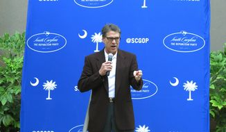 Texas Gov. Rick Perry speaks at a fundraiser for the South Carolina Republican Party on Wednesday, Aug. 27, 2014, in Columbia, S.C. Perry is visiting South Carolina for both politics and football in the first state in the south to vote in the presidential primaries. (AP Photo/Jeffrey Collins)