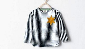 Spanish clothing retailer Zara yanked a shirt from its shelves after complaints that it too closely resembled the uniforms Holocaust victims were forced to wear while imprisoned in concentration camps. (Zara.com/Jewish Press)
