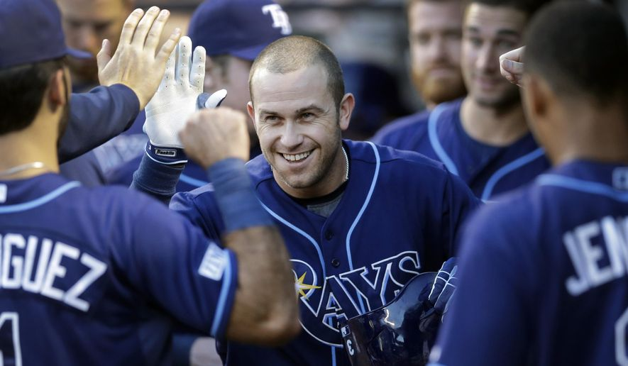 Tampa Bay Rays' Evan Longoria high-fives teammates in the dugout after hitting a solo home run in the first inning of a baseball game against the Baltimore Orioles, Thursday, Aug. 28, 2014, in Baltimore. (AP Photo/Patrick Semansky)