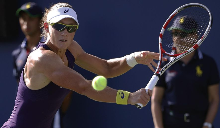 Samantha Stosur, of Australia, returns a shot against Kaia Kanepi, of Estonia, during the second round of the 2014 U.S. Open tennis tournament, Thursday, Aug. 28, 2014, in New York. (AP Photo/Kathy Willens)