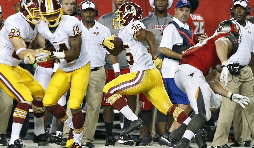 Washington Redskins running back Lache Seastrunk (35) runs upfield for an 80-yard touchdown catch and run during the third quarter of an NFL preseason football game against the Tampa Bay Buccaneers, Thursday, Aug. 28, 2014, in Tampa, Fla. (AP Photo/Brian Blanco)