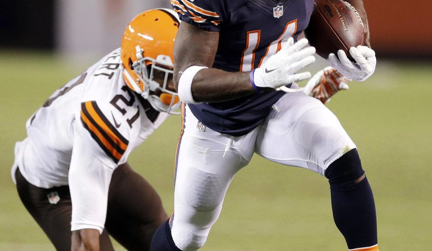 Chicago Bears wide receiver Santonio Holmes (14) beats Cleveland Browns cornerback Justin Gilbert on a 32-yard touchdown reception in the second quarter of a preseason NFL football game Thursday, Aug. 28, 2014, in Cleveland. (AP Photo/Tony Dejak)