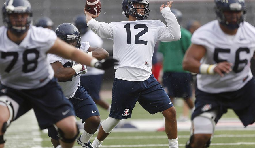 In this Aug. 2, 2014, photo, Arizona quarterback Anu Solomon throws a pass during NCAA college football practice in Tucson, Ariz. Redshirt freshman Anu Solomon emerged from a four-way race and will be Arizona's season-opening quarterback. Solomon will debut against his hometown team UNLV on Friday night, Aug. 29,  at Arizona Stadium, though coach Rich Rodriguez said the other quarterbacks may still see action. (AP Photo/Arizona Daily Star, Mike Christy)  ALL LOCAL TELEVISION OUT; PAC-12 OUT; MANDATORY CREDIT