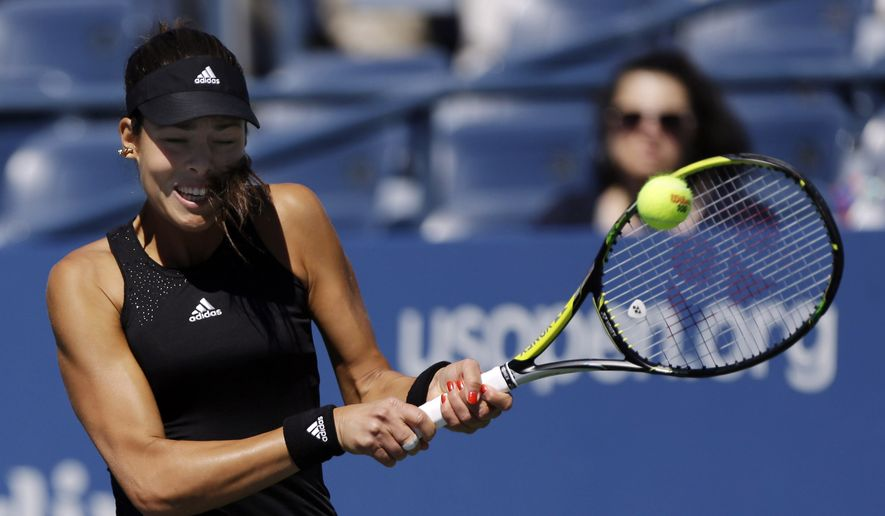 Ana Ivanovic, of Serbia, returns a shot against Kirolina Pliskova, of the Czech Republic, during the second round of the 2014 U.S. Open tennis tournament, Thursday, Aug. 28, 2014, in New York. (AP Photo/Frank Franklin II)