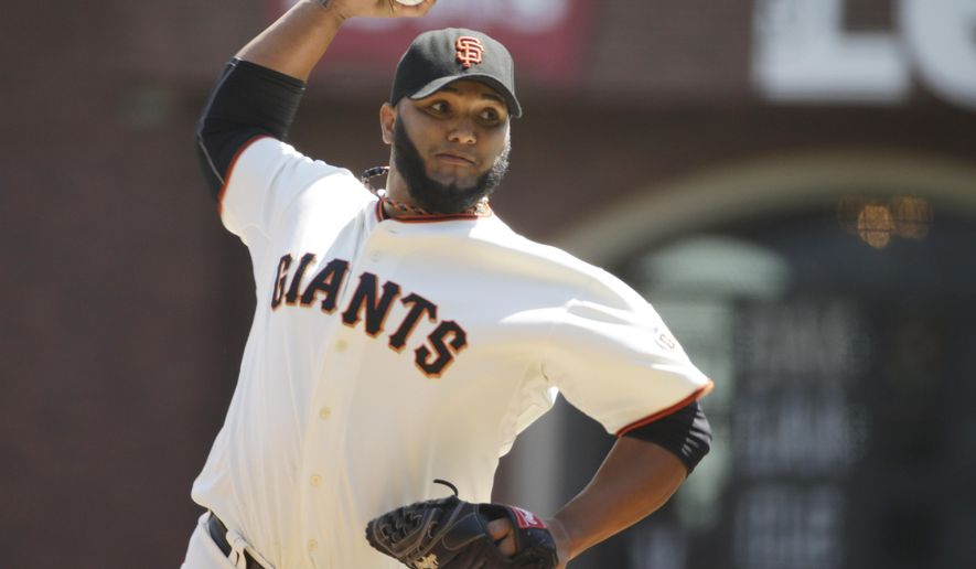 San Francisco Giants starting pitcher Yusmeiro Petit throws Colorado Rockies in the first inning of their game Thursday, Aug. 28, 2014, in San Francisco. (AP Photo/Eric Risberg)