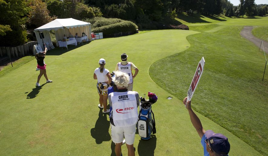 Gigi Stoll, 17, of Beaverton High School, tees off on the opening hole in the first round of the Portland Classic LPGA golf tournament, Thursday, Aug. 28, 2014, in Portland, Ore. (AP Photo/The Oregonian, Michael Lloyd)