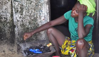 """""""If you cook on an open fire, have no electricity and go to bed hungry, you don't lie awake wondering about the virtue of coal, gas or solar,"""" said John Owusu, who worked for 50 years across all regions of Africa and was an early disciple of clean energy. (Associated Press/File)"""