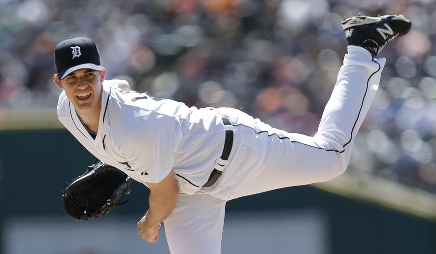 Detroit Tigers pitcher Kyle Lobstein throws against the New York Yankees in the first inning of a baseball game in Detroit Thursday, Aug. 28, 2014. (AP Photo/Paul Sancya)