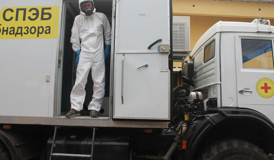 "Russian doctor Valentine Safronov stands inside a mobile medical lab donated by the Russian government to assist with the Ebola out-brake in Conakry, Guinea, Tuesday, Aug.  26, 2014.  The Ebola virus may have the ""upper hand"" in an outbreak that has killed more than 1,400 people in West Africa but experts can stop the virus' spread, a top American health official said at the start of his visit to the hardest-hit countries. (AP Photo/ Youssouf Bah)"
