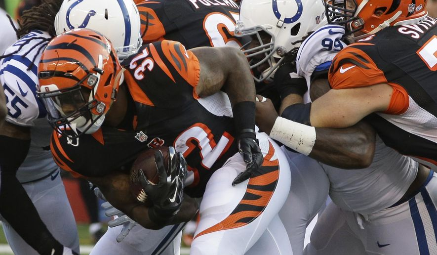Cincinnati Bengals running back Jeremy Hill (32) runs against the Indianapolis Colts in the first half of an NFL preseason football game, Thursday, Aug. 28, 2014, in Cincinnati. (AP Photo/Al Behrman)