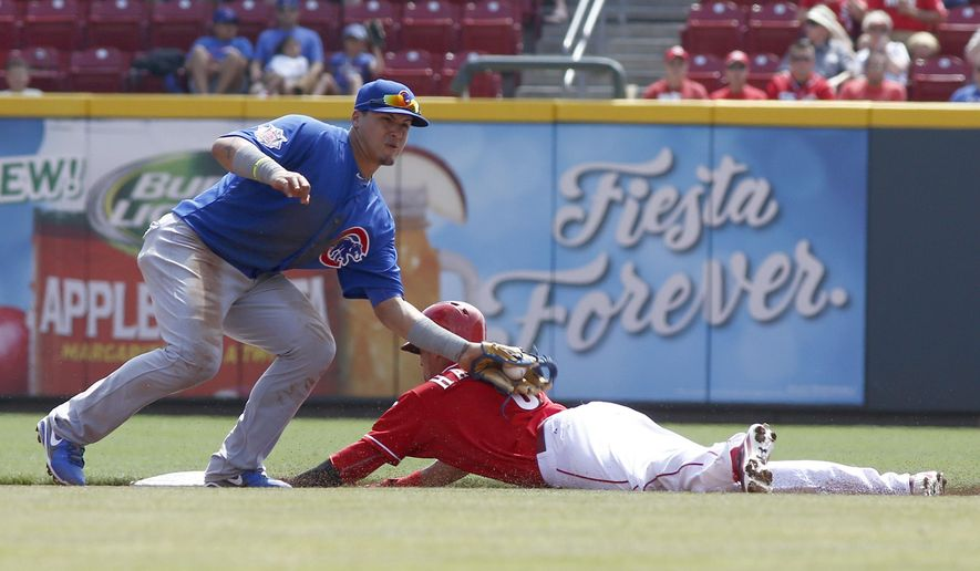 Cincinnati Reds' Billy Hamilton, right, steals second base under Chicago Cubs second baseman Javier Baez, left, in the first inning of a baseball game, Thursday, Aug. 28, 2014, in Cincinnati. (AP Photo/David Kohl)