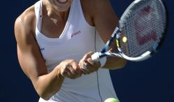 Kaia Kanepi, of Estonia, returns a shot against Samantha Stosur, of Australia, during the second round of the 2014 U.S. Open tennis tournament, Thursday, Aug. 28, 2014, in New York. (AP Photo/Kathy Willens)