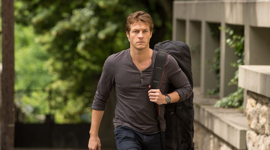 "This image released by Relativity Media shows Luke Bracey in a scene from the film, ""The November Man."" (AP Photo/Relativity Media, Aleksandar Letic)"