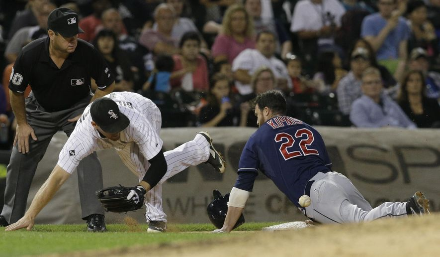 Cleveland Indians' Jason Kipnis (22), right, is safe at third base as Chicago White Sox third baseman Conor Gillaspie cannot make the catch during the sixth inning of a baseball game in Chicago, Thursday, Aug. 28, 2014. (AP Photo/Nam Y. Huh)