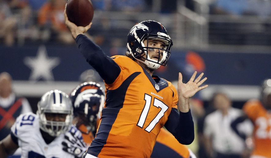 Denver Broncos quarterback Brock Osweiler (17) passes under pressure from Dallas Cowboys' Kenneth Boatright (91) in the first half of a NFL preseason football game, Thursday, Aug. 28. 2014, in Arlington, Texas. (AP Photo/Brandon Wade)