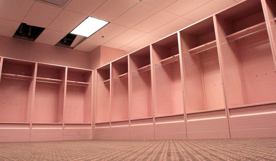 In this photo taken on Aug. 20, 2005, soothing pink colors adorn the visitors locker room at Kinnick Stadium in Iowa City, Iowa.  A University of Iowa professor is continuing his sometimes unusual efforts to repaint the school's famously pink visitors' locker room  (AP Photo/The Des Moines Register) MAGS OUT, TV OUT, NO SALES, MANDATORY CREDIT