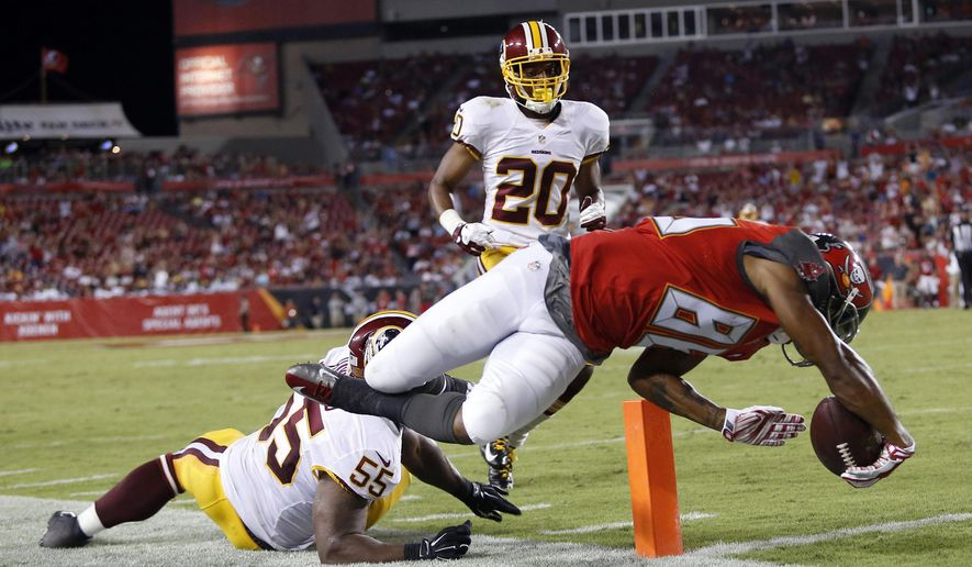 Tampa Bay Buccaneers wide receiver Solomon Patton (86) dives past Washington Redskins outside linebacker Adam Hayward (55) and cornerback Richard Crawford (20) to score on a 25-yard touchdown reception during the third quarter of an NFL preseason football game Thursday, Aug. 28, 2014, in Tampa, Fla. (AP Photo/Brian Blanco)