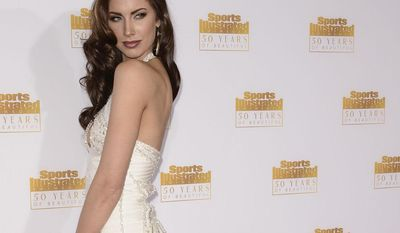 """Model Katherine Webb is engaged to Cincinnati Bengals QB A.J. McCarron. Katherine Webb arrives at the """"50 Years of Beautiful"""" television event celebrating the Sports Illustrated Swimsuit Issue's 50th Anniversary at the Dolby Theatre on Tuesday, Jan. 14, 2014 in Los Angeles. (Photo by Dan Steinberg/Invision/AP)"""