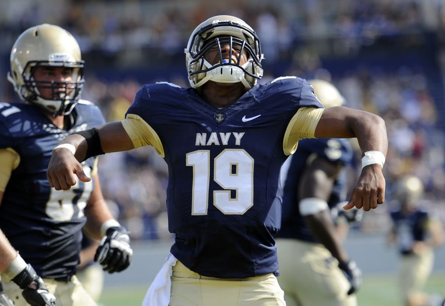Navy quarterback Keenan Reynolds (19) celebrates after scoring a touchdown during the second half of an NCAA football game against Air Force, Saturday, Oct. 5, 2013, in Annapolis, Md. Navy won 28-10. (AP Photo/Nick Wass)