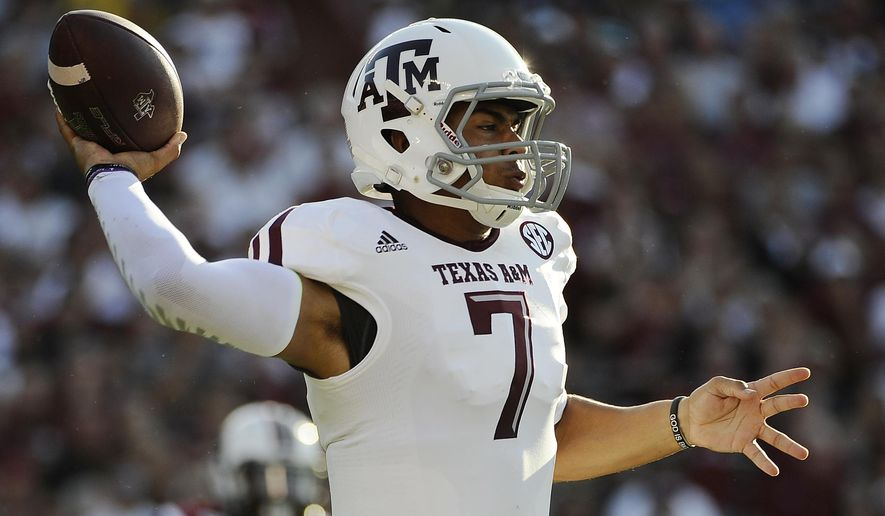 Texas A&M quarterback Kenny Hill (7) throws against South Carolina during the first half of an NCAA college football game on Thursday, Aug. 28, 2014, in Columbia, S.C. (AP Photo/Rainier Ehrhardt)