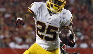 Washington Redskins running back Chris Thompson (25) is tripped by Tampa Bay Buccaneers defensive end Ronald Talley during the second quarter of an NFL preseason football game Thursday, Aug. 28, 2014, in Tampa, Fla. (AP Photo/Brian Blanco)