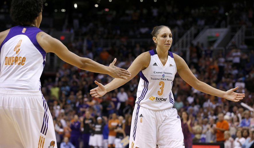 Phoenix Mercury's Diana Taurasi (3) slaps hands with Candice Dupree (4) after Taurasi made a foul shot during the second half in Game 1 of the WNBA basketball Western Conference semifinals against the Los Angeles Sparks on Friday, Aug. 22, 2014, in Phoenix. The Mercury defeated the Sparks 75-72. (AP Photo/Ross D. Franklin)