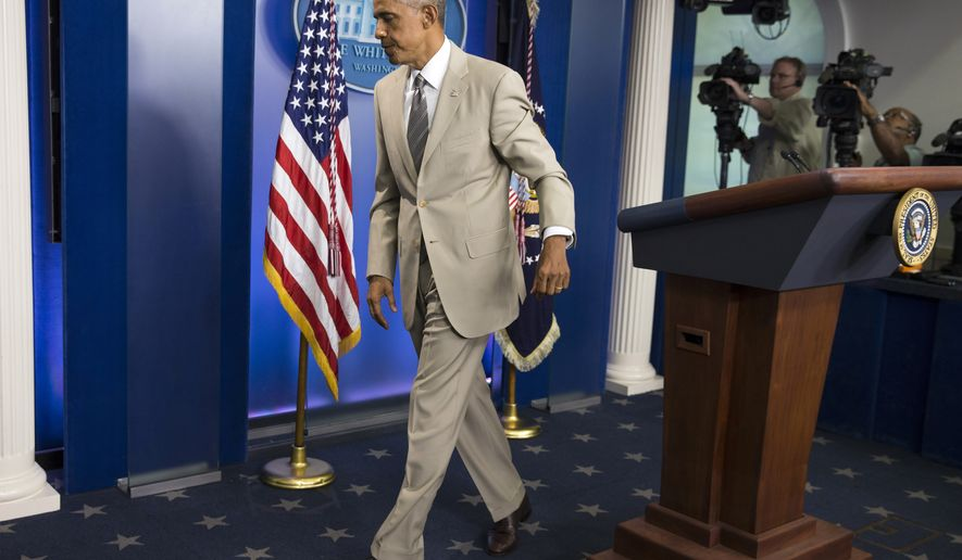 President Barack Obama leaves the James Brady Press Briefing Room of the White House in Washington, Thursday, Aug. 28, 2014, after speaking about the economy, Iraq, and Ukraine, before convening a meeting with his national security team on the militant threat in Syria and Iraq. (AP Photo/Evan Vucci)