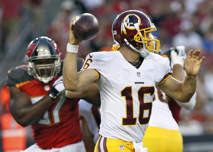Washington Redskins quarterback Colt McCoy (16) avoids a rush by Tampa Bay Buccaneers defensive tackle Akeem Spence (97) during the first quarter of an NFL preseason football game Thursday, Aug. 28, 2014, in Tampa, Fla. (AP Photo/Brian Blanco)