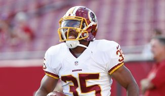 Washington Redskins safety Akeem Davis (35) warms up before the start of a preseason NFL football game against the Tampa Bay Buccaneers Thursday, Aug. 28, 2014, in Tampa, Fla. (AP Photo/Brian Blanco)