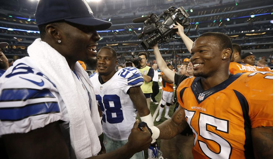 Dallas Cowboys' Dez Bryant, left, talks with Denver Broncos running back Kapri Bibbs (35) at midfield after their NFL preseason football game, Thursday, Aug. 28. 2014, in Arlington, Texas. Bibbs had two running touchdowns against the Cowboys in the  27-3 Broncos win. (AP Photo/Brandon Wade)