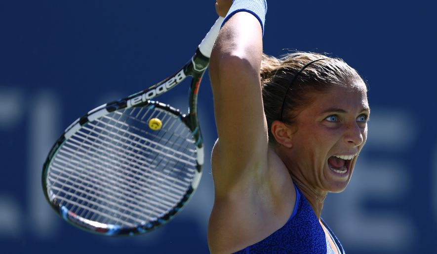 Sara Errani, of Italy, follows through on a shot against Venus Williams, of the United States, during the third round of the 2014 U.S. Open tennis tournament, Friday, Aug. 29, 2014, in New York. (AP Photo/Matt Rourke)