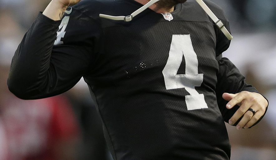 Oakland Raiders quarterback Derek Carr (4) celebrates after throwing a 36-yard touchdown pass to wide receiver Denarius Moore during the first quarter of an NFL preseason football game against the Seattle Seahawks in Oakland, Calif., Thursday, Aug. 28, 2014. (AP Photo/Marcio Jose Sanchez)
